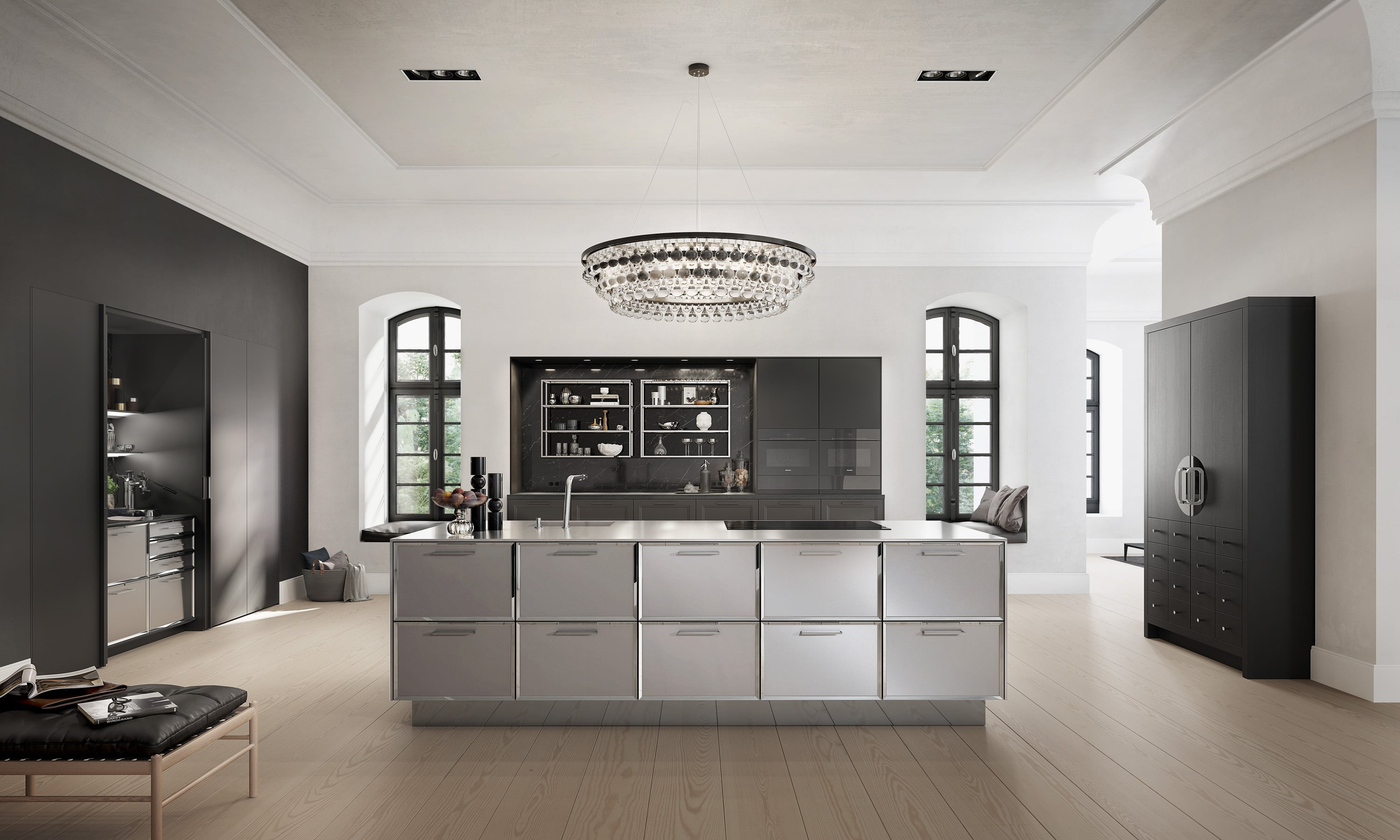 a classic siematic kitchen with stainless steel and nickel island