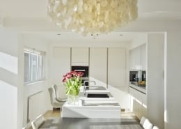 An image of a Siematic handleless kitchen in cream